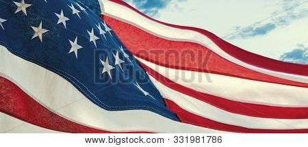 American National Holiday. Us Flag With American Stars, Stripes And National Colors. Sky Background.