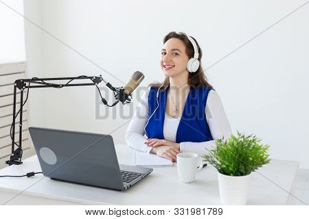 Radio, Blogging, Podcasting Concept - Young Woman Working As A Dj On The Radio.