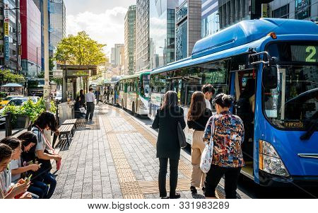 Seoul Korea , 23 September 2019 : People Getting On A Public Transportation Bus At A Stop In Seoul S