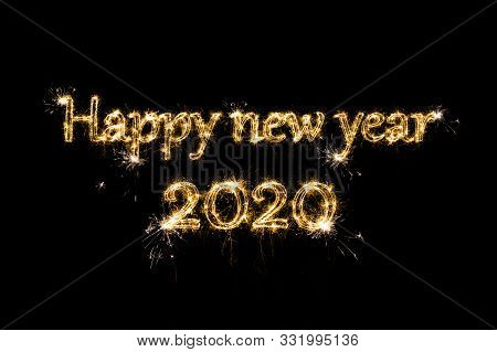Happy New Year 2020. Text Happy New Year 2020 Written Sparkling Sparklers Fireworks Isolated On Blac