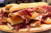 Spanish tapas street food, bocadillo fresh bread with jamon iberico ready to eat poster
