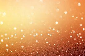 Abstract Orange Bokeh Background. Christmas Glittering Background. Abstract Christmas Background. Gl