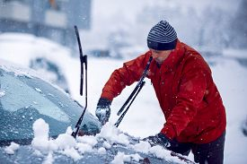 Frozen Car Covered Snow At Winter Day.cleaning Car Windshield Of Snow Winter.man Clears Snow From Ic