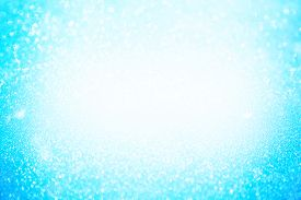 Abstract Bokeh Background. Christmas Glittering Background. Abstract Christmas Blue Color Background