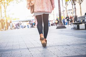 Woman Legs Walk On Street. Woman Legs Walk On Street In Brown Shoes. Woman Legs Back View. Close Up