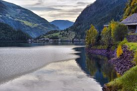 Beautiful View Of A Mountain Lake In The Autumn Sunny Day. Poschiavo, Switzerland