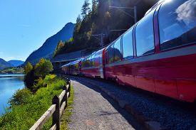 Ernina Express Train In The Mountains Of Switzerlandm Switzerland, Poschiavo,