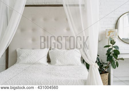 Home Bedroom Interior, Closeup At Bed Design. Modern Apartment With Minimalistic Luxury Style, White