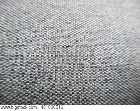 Closeup Grey Fabric Texture With Copy Space. Macro Shot Of Gray Upholstery For Furniture. Selective