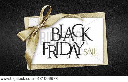 White Gift Card With Golden Ribbon Bow And Black Friday Sale Text, Isolated On Black Background Temp
