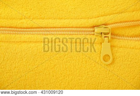 Detail Of A Bright, Yellow, Fleece Jacket With A Zipper For Autumn Or Winter, As A Background.the Co