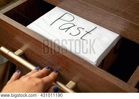 Close-up Of White Box With Inscription Past In Open Drawer Of Wooden Cabinet, Which Is Closed By A W
