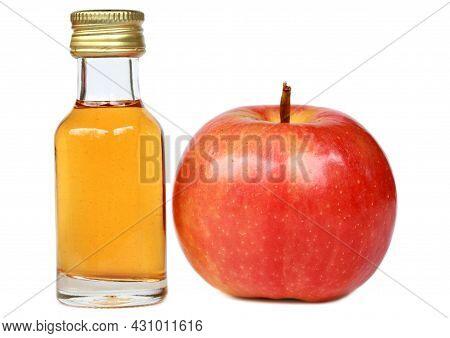 Apple And Apple Cider Vinegar In Glass Bottle On White Background