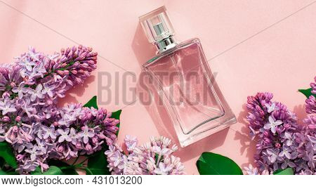 A Bottle Of Perfume And Lilac On A Pink Background . Womens Perfume. Spring Fragrance. Aromatherapy.