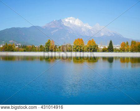 Qingxi Reservoir With Jade Dragon Snow Mountain In The Background. Lijiang, Yunnan, China