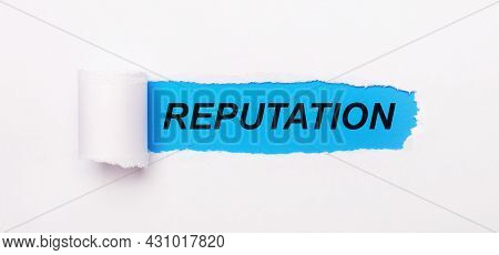 On A Bright Blue Background, White Paper With A Torn Stripe And The Text Reputation