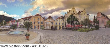 Frohnleiten, Austria- June 25, 2021: The Main Square With Old Buildings And Parish Church In The Cha