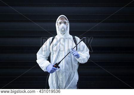 Professional Exterminator Holding Sprayer Equipment For Pest Control.