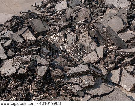 Repair Of Asphalt Pavement. Old Gray Asphalt Piled High. Background.