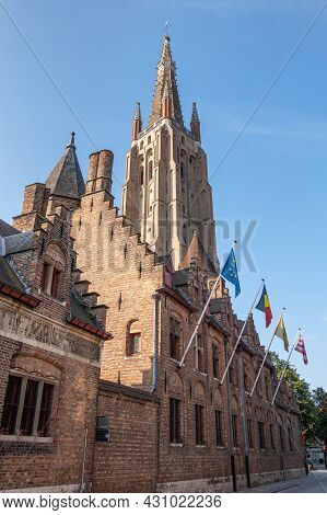 Brugge, Flanders, Belgium - August 4, 2021: Red Brick Building On Street Side Of Gruuthuse Palace An