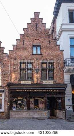 Brugge, Flanders, Belgium - August 4, 2021: Historic Red Brick House With Stair Gable Became The Old