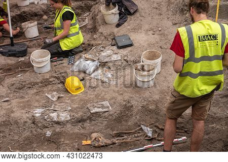 Brugge, Flanders, Belgium - August 4, 2021: Unearthed Skeleton At Archaeology Dig On Former Cemetery