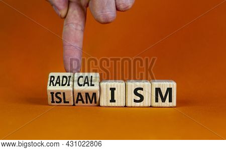 Radicalism Or Islamism Symbol. Businessman Turns Cubes And Changes The Word 'radicalism' To 'islamis