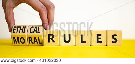 Ethical Or Moral Rules Symbol. Businessman Turns Wooden Cubes And Changes Words 'ethical Rules' To '