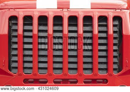 Fire Engine Radiator Grill. Car Radiator Grille Fire Close-up Shot