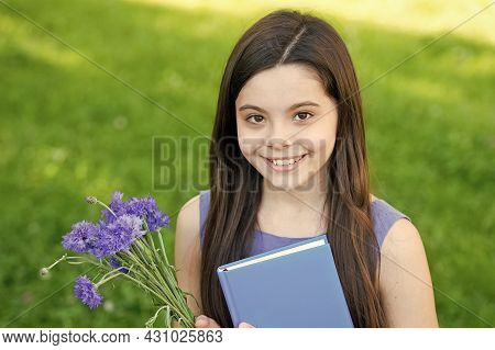 Happy Childrens Day. Happy Girl Got Flowers For Childrens Day. Little Child On Summer Outdoor. Child