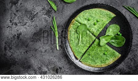 Delicious Spinach Crepes Green Colored Pancake With Vegetables On Black Plate, Dark Background, Food