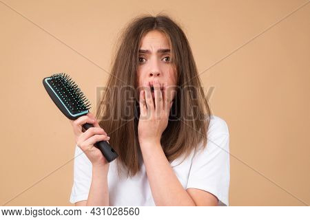 Haircare. Straightening Woman And Treatment Of The Hair. Girl With Straight Brushed Hair. Hair Tangl