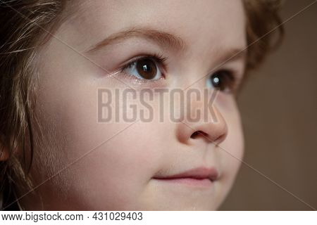 Close-up Portrait Of Cheerful Child. Cute Joyful Little Boy Kid. Close Up Portrait Of Funny Little C