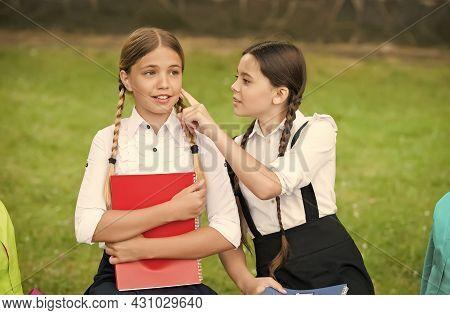 Little Child In School Uniform Touch Skin Of Girl Classmate Sitting On Park Bench, Skincare