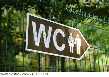 Toilet Sign In The Park. Toilet Sign For Women And Men. How To Get To The Toilet .