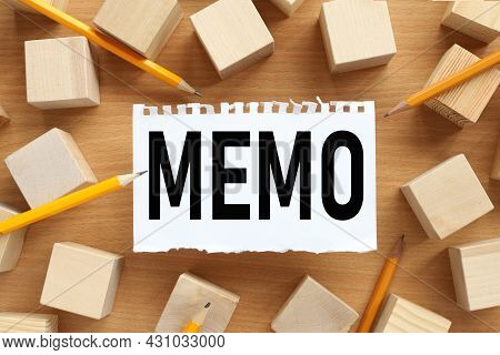 Memo . Business Memo Concept. Text On White Torn Paper. Near The Wooden Cubes