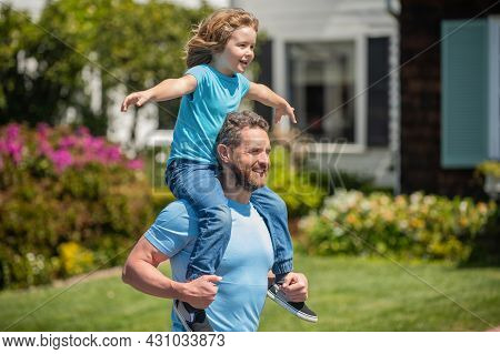 Parent Hold With Small Child Boy. Dad With Kid On Summer Day. Parenting And Fatherhood.