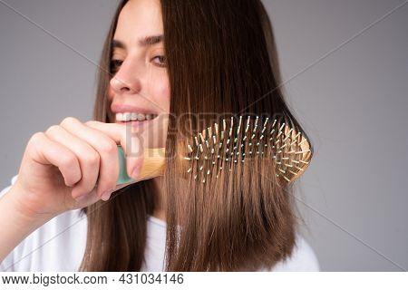 Close Up Woman Combing Hair. Hair Care. Beautiful Brunette Woman Hairbrushing Hair With Hairbrush. B