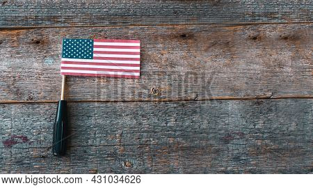 American Flag And A Screwdriver Sequins On A Wooden Background, Flat Lay. A Holiday In America.happy