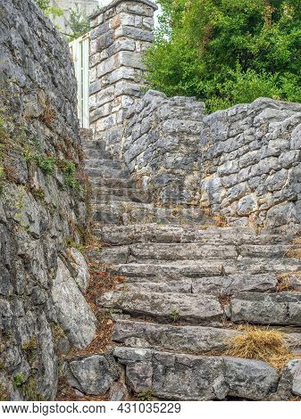 An Ancient Stone Staircase Is Leading Upwards.