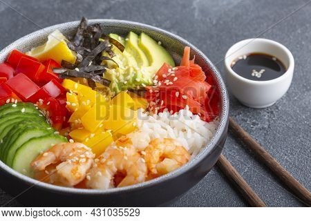 Hawaiian Shrimp Poke Bowl With Seaweed, Avocado, Rice, Pepper, Cucumber, Ginger, Sesame Seeds, Soy S