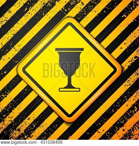 Black Christian Chalice Icon Isolated On Yellow Background. Christianity Icon. Happy Easter. Warning