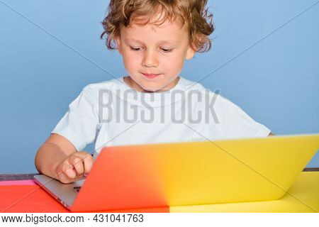 Happy Cute Clever Boy Pupil With Laptop. Child From Elementary School. Cheerful Smiling Child Use La