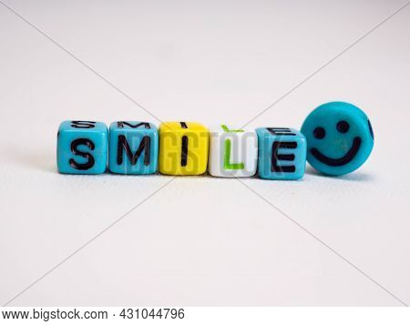S M I I L E Letters With A Smile Icon On A White Background
