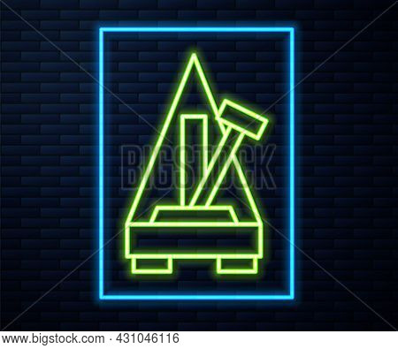 Glowing Neon Line Classic Metronome With Pendulum In Motion Icon Isolated On Brick Wall Background.