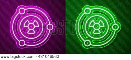 Glowing Neon Line Radioactive Icon Isolated On Purple And Green Background. Radioactive Toxic Symbol