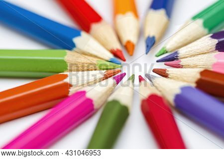 Close Up Of The Tips Of Coloured Pencils Arranged In A Radial Pattern With The Leads Pointing Toward