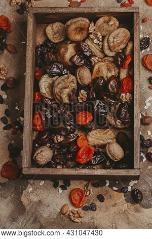 Healthy Food Dried Fruits. Prunes, Dried Apricots, Raisins, Figs, Nuts. Top View. Copy Space.