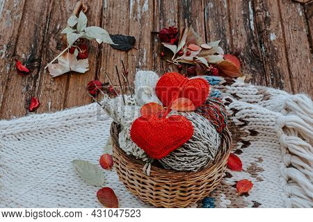 Autumn Knitting Of Warm Clothes. Woolen Balls Of Knitting Needles Knitted Hearts. Self-made Things W