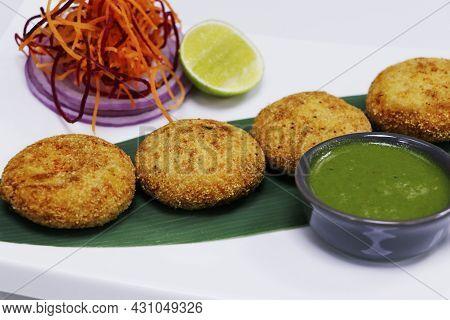 Dahi Kebab, Deep Fried Spiced Yoghurt Patties Rolled With Semolina , Indian Street Snack Food